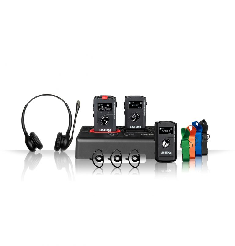 Product image of ListenTALK transceivers in docking station with headphones and lanyards.
