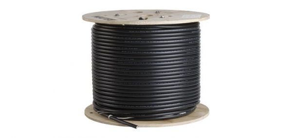 Photo of coaxial cable rolled up around a wooden case
