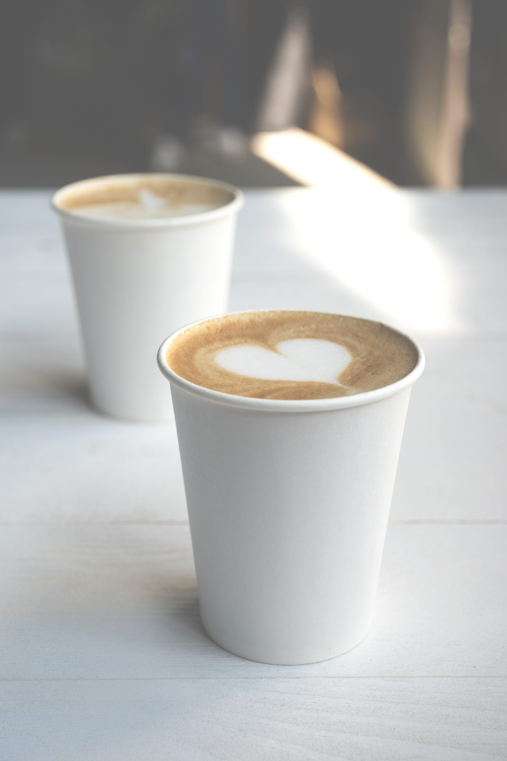 Two Identical cups of coffee