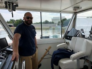 Boat captain at the wheel on a river tour