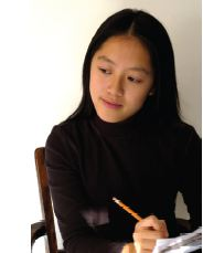Asian woman writing on paper