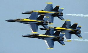 Photo of the Blue Angels jets in the air during an air show.