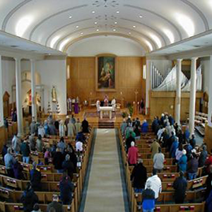 Aerial view of church congregants standing up during a service.