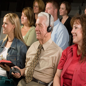 Man using assistive listening device during church service