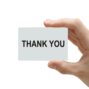 Hand with Thank You written on card