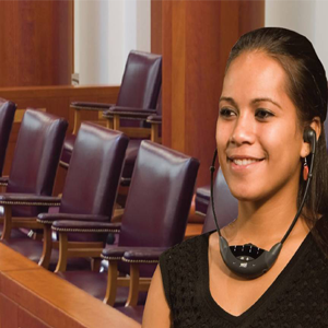Young woman wearing a ListenIR receiver stethoscope in a courtroom