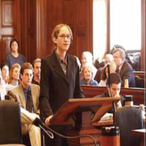 Professional business woman standing at a pulpit