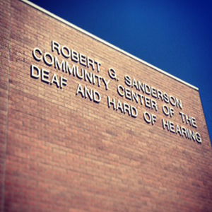 Robert G. Sanderson Community Center of the Deaf and Hard of Hearing signage on building
