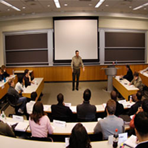 Man speaking to group of people in a classroom