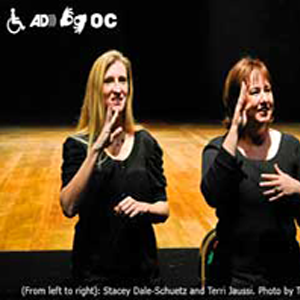 Women doing sign language to audience