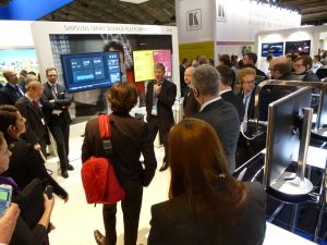 Group of people observing a presentation at a Pro A/V tradeshow.