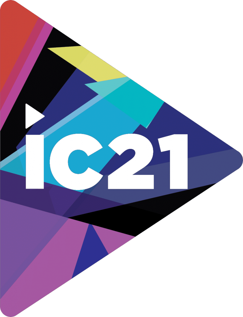 """A logo that is a triangle shaped like a play button filled with geometric shapes and different colors that says """"ic21"""" in the middle for infocomm 2021"""